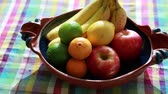runners : a thing of mixed fruit on the table in a pottery dish Stock Footage