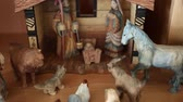 cow birth : A beautiful russian hand carved Nativity Creche set out in the home for the holidays dolly shot Stock Footage