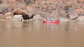 sandálias : Boaters float down the colorado river near Moab Utah in Southern Utah