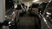 muçulmano : cars and people inside a busy parking garage steadicam Stock Footage