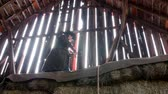 ponte : Cowboy plays an old fiddle in barn rafters for barn dance