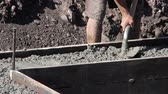 sağlam : Flattening cement with shovel Stok Video