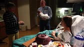 Следы : family members visit the hospital after a woman gives birth to a baby boy Стоковые видеозаписи