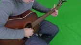 бить : Green screen of a man playing the guitar