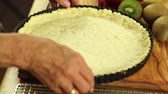 масло : lady preparing a fresh berry fruit tart desert crust