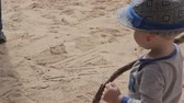 little : a little boy playing in sand at capitol reef national park Stock Footage