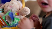 animal egg : A little boy on easter morning searching for his easter basket and eggs with his family in his home Stock Footage