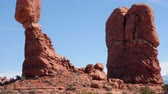 sal : People by the balancing rock at Arches National Park Utah