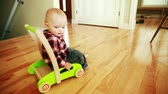 brinquedos : a little baby boy playing with a push toy
