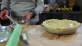 dortík : woman brushes pie crust with egg