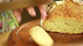 cut off : woman slicing fresh artisan bread Stock Footage
