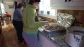 pork meat : a woman making homemade meat pies in a kitchen