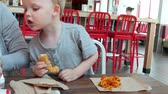 batatas fritas : A family eating a lunch at a clean and modern fast food restaurant