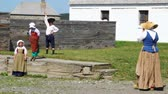 vojsko : Children playing at the Fortress of Louisbourg in Nova Scotia Canada