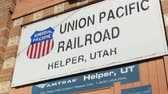 pomocník : HELPER UTAH, USA- March 2015: The Union Pacific Railroad sign in the small town of Helper Utah