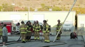 rescue : firefighters putting out a fire at a warehouse Stock Footage