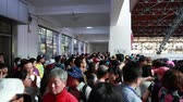 harcos : Tourists at the Terra Cotta Warrior Museum in Xian China during a Chinese holiday and tons of people