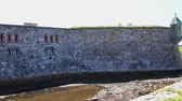 роль : The mote at the French Fort and 18th Century Colonial Town at Louisbourg Nova Scotia Canadian National Park.