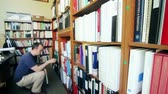 arquivo : a man looks through the office library archive Vídeos