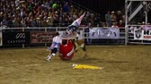 corajoso : Professional PRCA rodeo clown jumps over a crazy bull