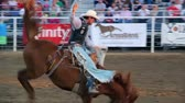 corajoso : Riding a saddle bronc at the rodeo