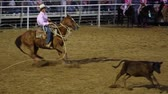 corajoso : Cowboys calf roping at a national PRCA rodeo