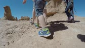 hidrasyon : A flying shot of families walking around Goblin Valley State Park in the hot desert of Southern Utah. Shot using a gimbal for smoothness. Stok Video