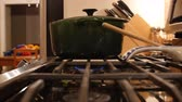 cooks : A green pot sits over a gas burner flame Stock Footage