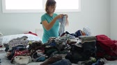 housekeeping : A mother sorts through the kids clothes