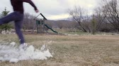 запустить : A slow motion shot of a boy kicking a snowman