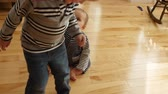 madeira de lei : A toddler walking in circles around his baby brother