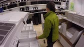 skandinávský : A woman looking through ikea to look at furniture