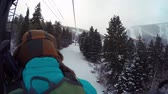 осина : A woman riding on ski lift on cold day