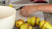 peeling onion : A woman slicing pears in the kitchen Stock Footage