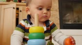 madeira de lei : Adorable baby boy playing on family room floor with toys Stock Footage