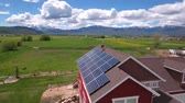 fotovoltaik : Aerial shot of flying over house with solar panels in spring Stok Video