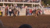 запустить : Editorial A Cowboy riding bareback in PRCA rodeo event
