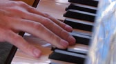 escala : Fingers playing keys of a beautiful black grand piano
