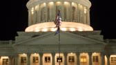 administrativo : Flag flies at the Utah State Capitol at night rack shot Stock Footage