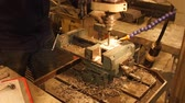 lakatosmunka : Man drills through thick metal piece