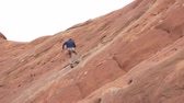 udatnost : Man repelling on redrock in southern utah