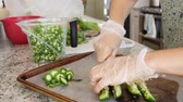 peeling onion : Woman cuts jalapenos for salsa in her kitchen Stock Footage