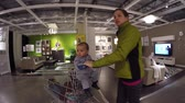 inexpensive : Woman with kids looking at furniture in IKEA