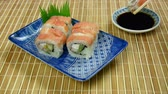 asya mutfağı : Salmon Sushi Roll Eaten (HD). A delicious Salmon Sushi roll eaten quickly after tray is placed. Used a higher speed to show the rapid eating.  Stok Video