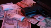 бумага : Mexican Drug Bust Pan Right (HD). This shot shows a gun with Mexican money scattered and a few bags of cocaine in bags. Shot to the right.