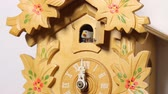 obraz : Cuckoo Clock Twelve Chimes (HD). Vintage style Cuckoo clock chimes twelve times showing bird while camera changes angles from the ticking pendulum to the house bird. Audio included.
