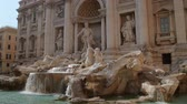 europa : Trevi Fountain Rome Italy (HD). Trevi Fountain in Rome Italy seen from an angle. All signs and people faces on the left side rotoscoped out. Ambient audio with people chattering and water dropping. Wideo