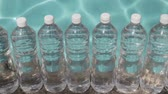 точка зрения : Water Bottles Liquid Background (HD). Row of generic unbranded water bottles with ripple water background.