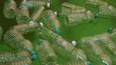 atık : Bottles Floating On Polluted Water (HD). Plastic water bottles from different kinds floating on greenish polluted water closer view.