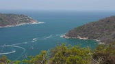 defne : Puerto Marques Bay Mexico (HD). View of Puerto Marques bay near Acapulco showing the end of the mountain ridges entering the sea. Mexican Pacific coast. Stok Video